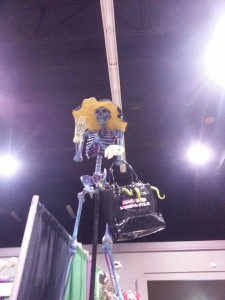 Mercy Macabre standing atop the booth waving to her fans.